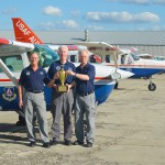 """(L to R) Group V team members Lt. Col. Mike Duc and Lt. Col. Roger Corbin from David Lee """"Tex"""" Hill Composite Squadron and Maj. Jan Wagner from Bexar Senior Squadron proudly showing off their first place trophy."""