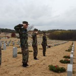 Cadets Chief Master Sgt. Emelia  McLaughlin, Airman 1st Class Sam Goldfarb and Airman Christian Gray and Ashton Kitchens salute after placing wreaths on veterans' graves at the Dallas-Fort Worth National Cemetery.