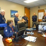 Incident Commander Maj. Ken Wiggins from the West Houston S.A.B.R.E. Senior Squadron (2d from left) briefs other members of the Texas Wing.