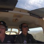 Second Lt. Mark C. Chin (on right), 441st Composite Squadron, pilots the aircraft on his initial mountain certification flight with Lt. Col. Don R. Fisher, Baytown Senior Squadron, along as safety pilot.