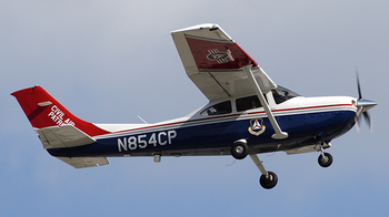 A CAP Cessna 182 takes off on a mission.